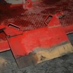 een van de hydraulische messen uit de sleepvoet